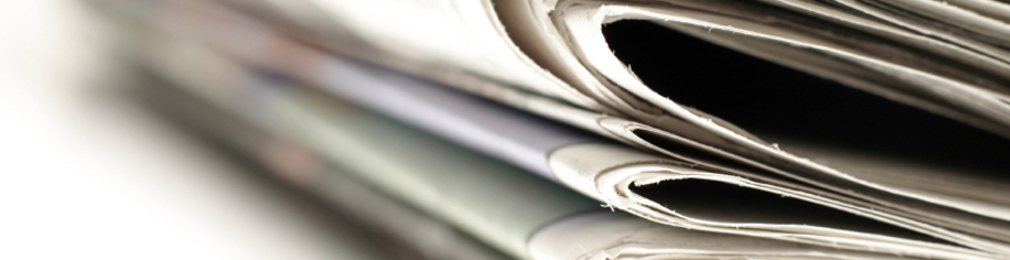 A close up of folded newspapers